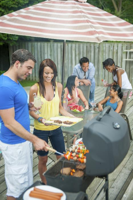 Adults grilling