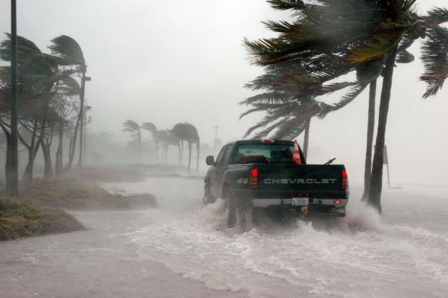 Truck driving through hurricane force wind and flooding