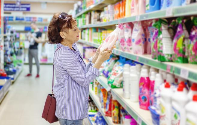 Woman checking the label on a product at the store