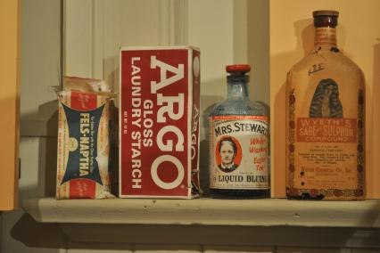 Old cleaning products on a shelf