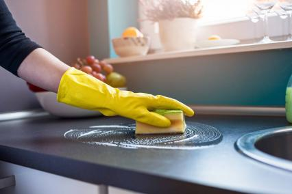 Woman cleaning counter tops