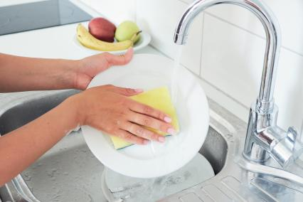 Washing dishes with a sponge
