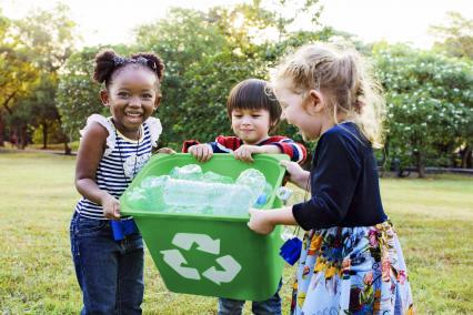 Kids helping to take out recycling