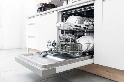 Open dishwasher full of dishes