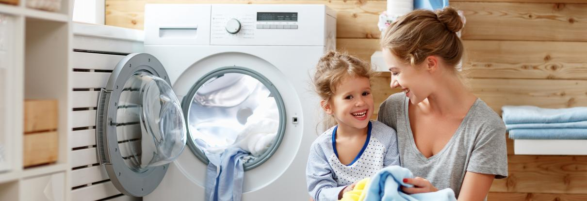 Mother and child doing laundry together